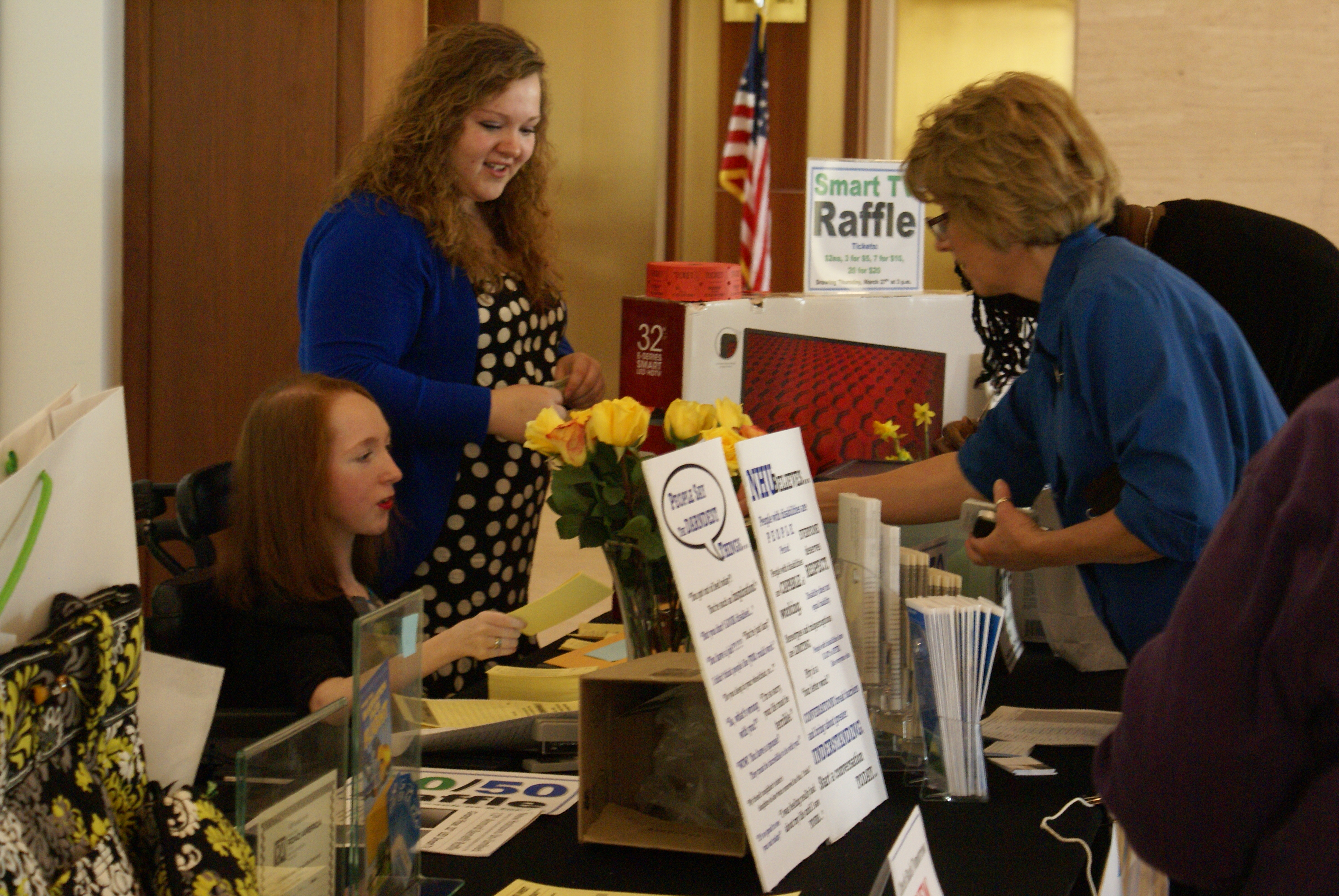 Raffle participants purchasing tickets from our NHU volunteers at our event